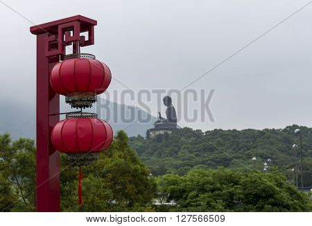 Tian Tan Buddha - The worlds's tallest bronze Buddha in Lantau Island, Hong Kong, with a Chinese lantern in the foreground