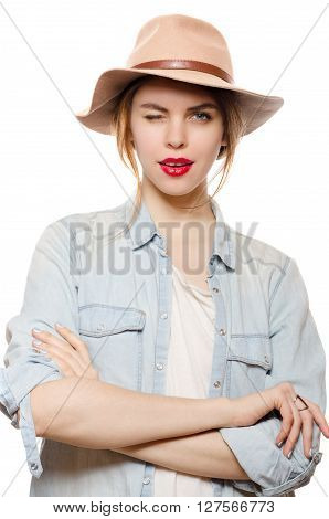 Attractive smiling woman in a hat winking eye