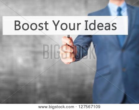 Boost Your Ideas - Businessman Hand Holding Sign