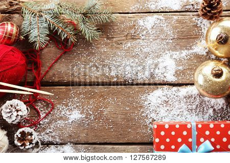 Christmas composition with gift box and decorations on a wooden table