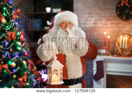 Santa Claus with lantern Christmas interior background
