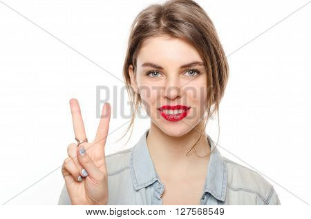 Happy Smiling Beautiful Young Woman Showing Two Fingers Or Victory Gesture, Isolated Over White Back