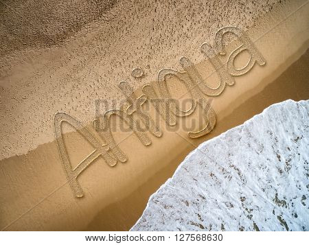 Antigua written on the beach