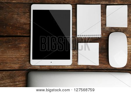 Set of office stationery with a computer on a wooden background