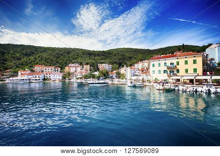 VALUN CROATIA - August 26 2914: View to the village Valun with harbor and boats Cres island Croatia