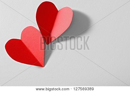 Red paper heart isolated on white background with copy space
