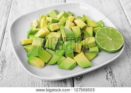 Cubes of fresh avocado on plate closeup