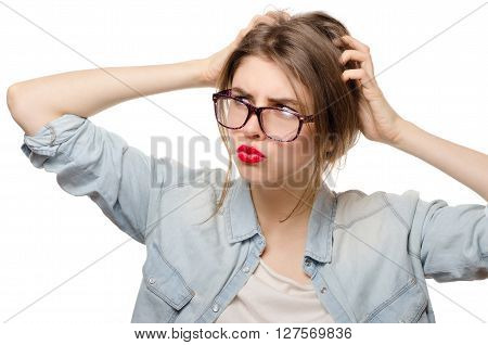 Closeup portrait of young woman scratching head. Thinking cogitative woman