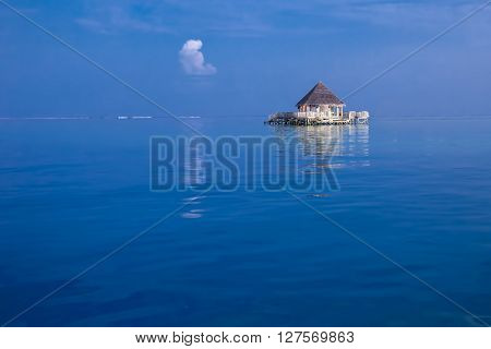 Overwater bungalows with tourquise clear water in tropical island