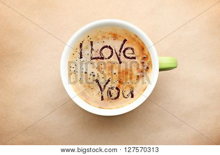 Cup of coffee with words I love you, top view