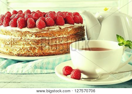 Tasty cake with fresh berries and cup of tea. Retro style