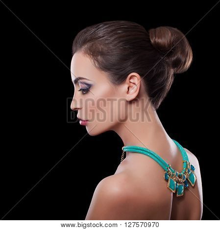 Beautiful Skinny Brunette Woman profile portrait. Beauty Luxury Makeup and Black Dress. Gorgeous Fashion Model Girl Portrait Isolated on a white background.