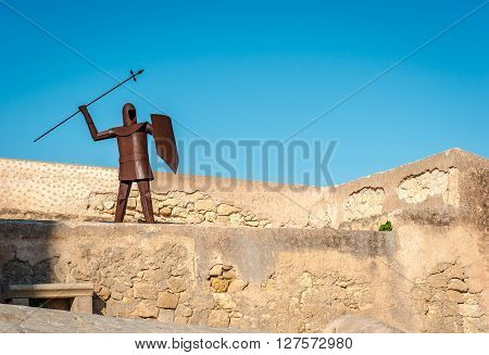 The rusty knight in the Santa Barbara castle, main tourists attraction in Alicante city. Spain