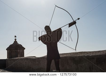Silhouette of a archer in the Santa Barbara castle, main tourists attraction in Alicante city. Spain