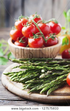 Uncooked Asparagus With Tomato On The Vintage Table