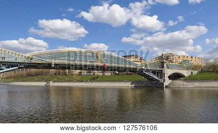 MOSCOW, RUSSIA - APRIL 24, 2016: Pedestrian bridge Bogdan Khmelnitsky or Kyivskiy pedestrian bridge over the Moscow River connects Berezhkovskaya and Rostovskaya embankments near Kievsky railway station