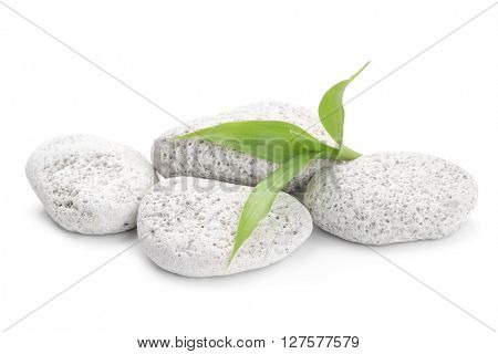 zen basalt stones and bamboo on the white background