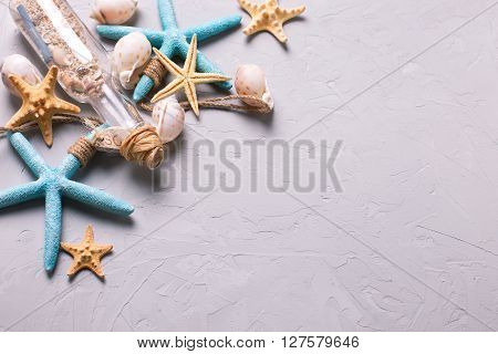 Marine items on grey tetured slate background. Sea objects. Selective focus. Place for text.