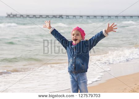 Seven-year Girl Rejoices Arrival Of The Sea On The Coast In The Spring