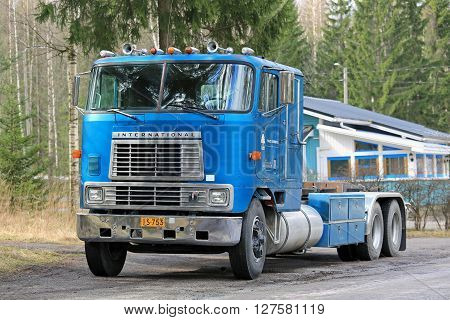SALO, FINLAND - APRIL 24, 2016: Classic blue International Eagle 9670 cab over heavy duty truck parked along road in South of Finland.