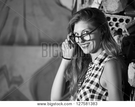 pretty young blond woman with glasses looking at camera
