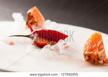 Liquid nitrogen treated salmon and chili pepper