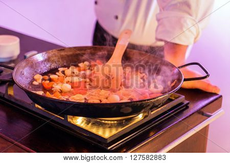 chef making paella