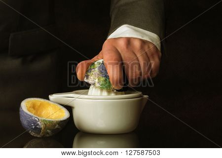 a Businessman in suit squeezes the Earth