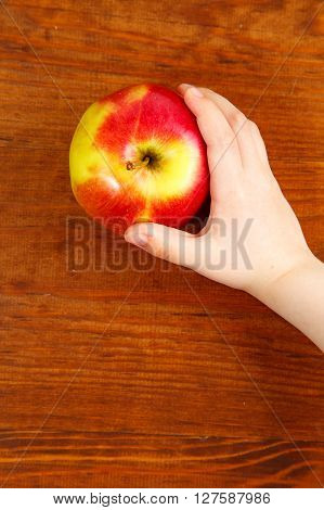 Children Holding Red Apple. Top View. Vertical Shot