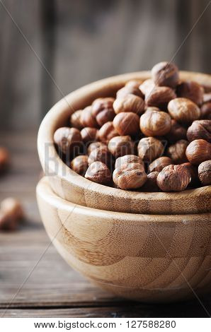 Raw Healthy Hazelnut On The Wooden Table