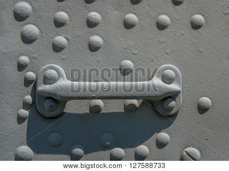 iron plate with rivets and handle gray