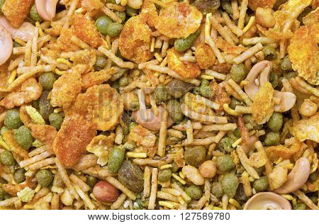 Dry roasted Indian snack mix, close-up background