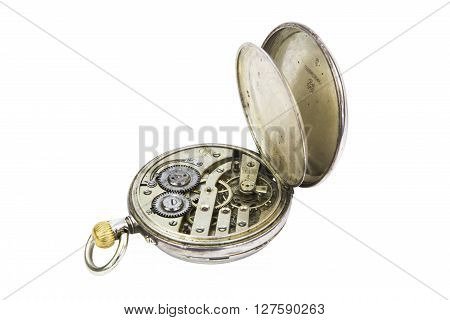 Old gold pocket watch mechanism isolated on white background