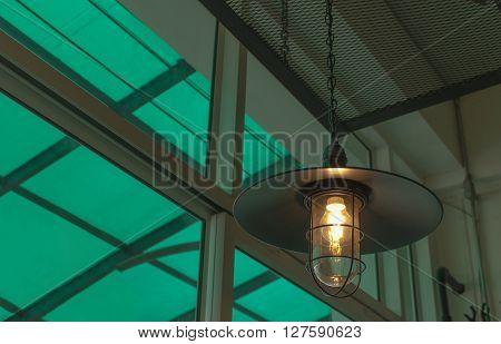 Lighting decor ;Decorative antique edison style light bulbs against background