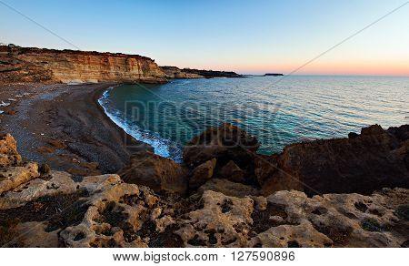 Sunset on a beautiful rocky beach. Cyprus the Akamas peninsula.
