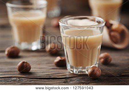 Italian Hazelnut Liqueur On The Wooden Table