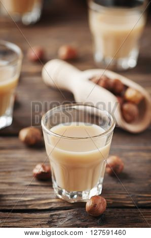 Traditional Italian Hazelnut Liqueur On The Wooden Table