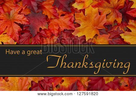Happy Thanksgiving Greeting Fall Leaves Background and text Have a great Thanksgiving