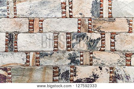 Old weathered stone wall for background or texture