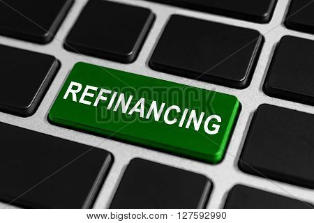 refinancing green button on keyboard business concept