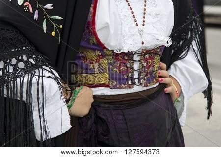 QUARTU S.E., ITALY - September 15, 2013: Wine Festival in honor of the celebration of St. Helena - Sardinia - Details of traditional Sardinian costumes of the folk group