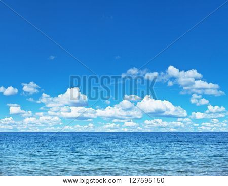 Seascape with calm sea and cloudy sky.
