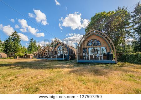 Cosy wooden camping bungalows in a forest.