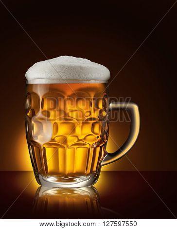 Mug of beer on the dark brown background.