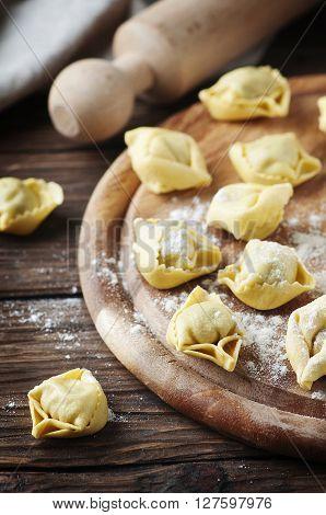 Italian Homemade Tortellini On The Wooden Table