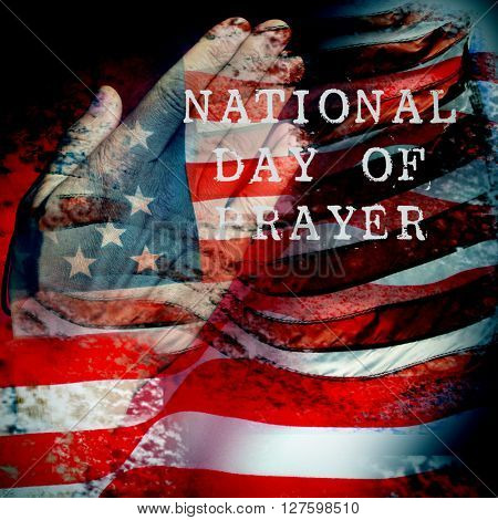 a double exposure of the flag of the United States and a the hands of a young caucasian man praying, and the text national day of prayer