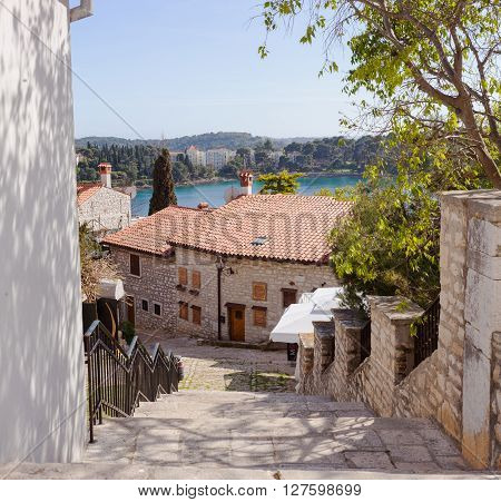 Alley of Rovinj the sea in the background