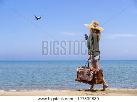 Woman on the beach - Travel concept