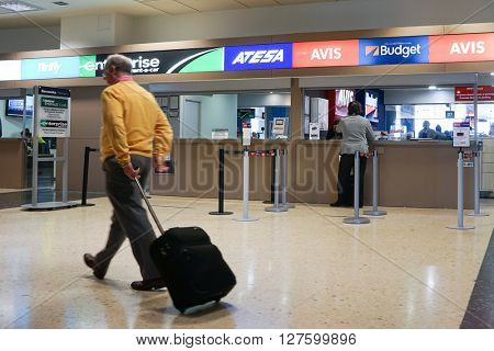 VALENCIA, SPAIN - APRIL 21, 2016: Rental car counter at the Valencia, Spain Airport. Approximately 4.98 million passengers passed through the Valencia airport in 2015.