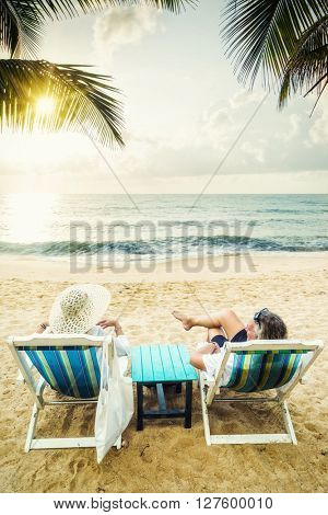 Couple on their honeymoon at the beach at sunset